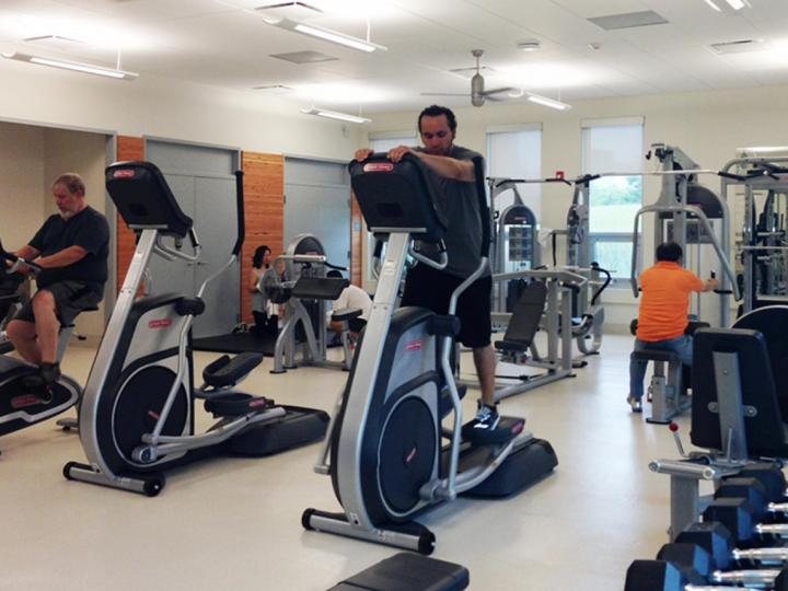 Adults working out at Ping Tom Park Fitness Center