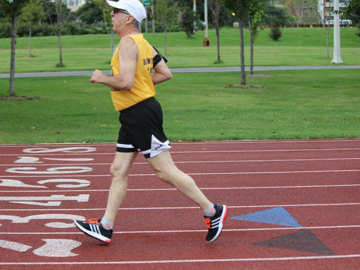 Senior running on the track at Wilson and LSD on the lakefront