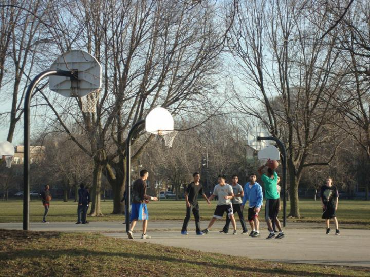 Men playing basketball on the outdoor court at Warren Park