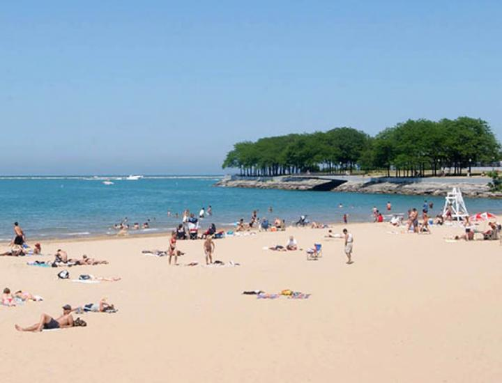 Visitors enjoy a beautiful sunny day at one of Chicago's beaches.