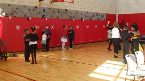 Kids dancing in the gym.