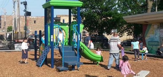 Kids having fun in the new Chicago Plays! playground at Mozart Park