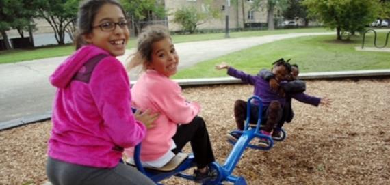 kids having fun at Ronan Playlot Park playground.