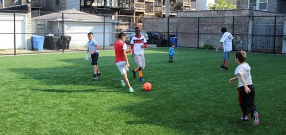 Kids enjoying a game of soccer.