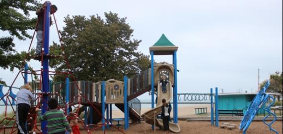 Kids enjoying the newly renovated Chicago Plays! playground at Loyola Park.
