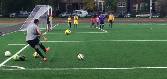 Soccer player practicing at the newly renovated field at River Park.