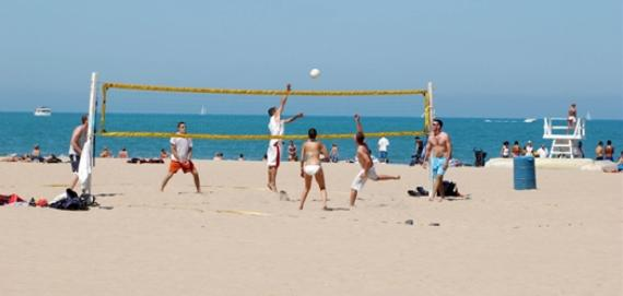 Beach goers enjoy volleyball at Oak Street Beach.