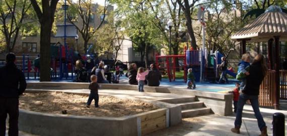 Families enjoy the playground at Supera Park.