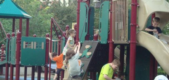 kiddos climbing at Adams Playground