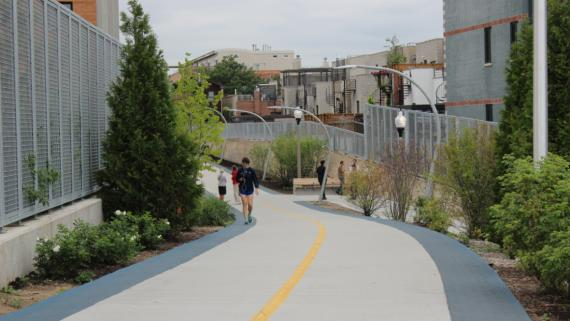 Community members walking/running along the Bloomingdale Trail