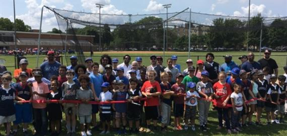 Ribbon cutting at Loyola Park for the batting cage funded by CubsCare