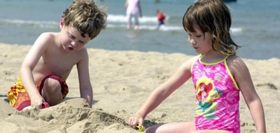 Children building sand castles at North Avenue Beach.