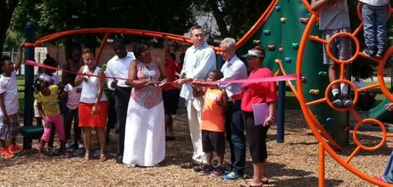 Community ribbon cutting for the new Chicago Plays! playground at Burnside Park