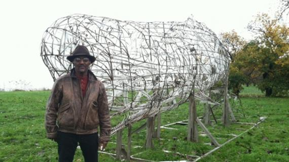 Artist Preston Jackson in front of Shirley Armstrong - Whale sculpture