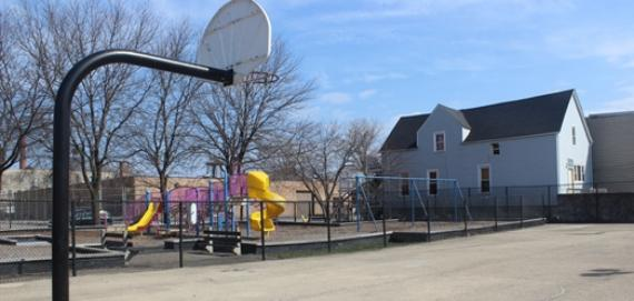 View of basketball court and playground at Monticello Park.