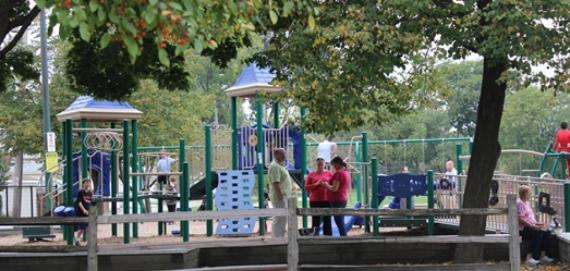 Community members enjoying a day in the playground at Brooks Park