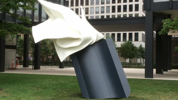 Giant pocket with a handkerchief sticking out and blowing in the wind.