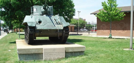 Tank and monument honoring veterans