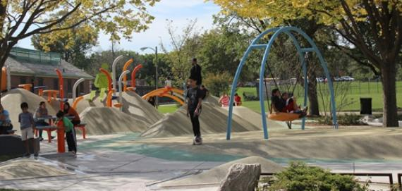 Check out the amazing playground at Riis Park. Kids playing.