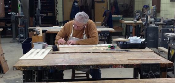 Adult working on project in the Horner Park woodshop.