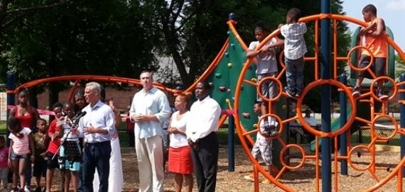 Community residents celebrate the new Chicago Plays! playground at Burnside Park