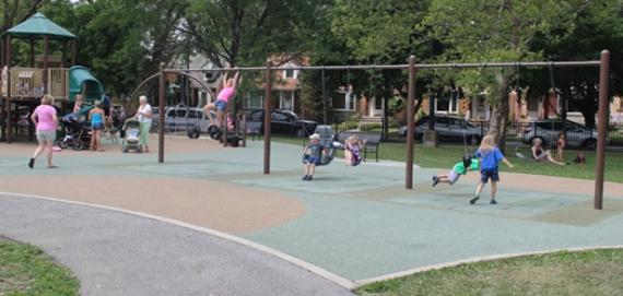 Indian Road playground with kids on swings