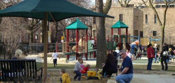 Families gather at the playground for a day of fun.