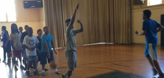 Campers have a good time playing basketball.