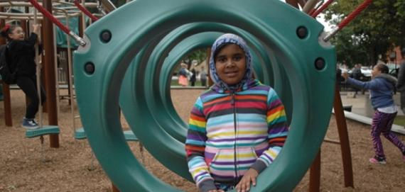 Young girl playing in the new Chicago Plays! playground at Green Briar Park