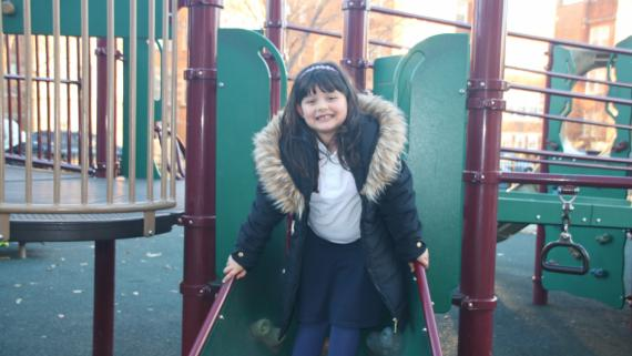 Happy girl enjoying our playground equipment