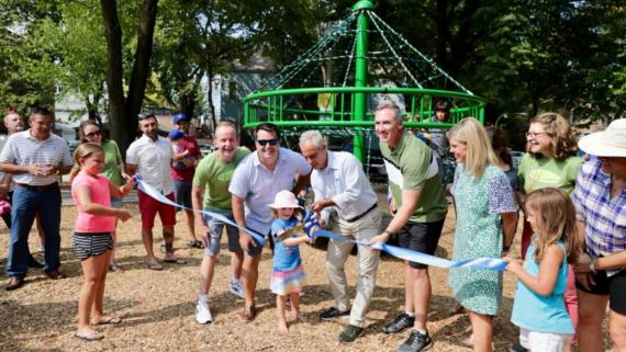 Cutting the ribbon on the newly updated Juniper Park playground equipment.