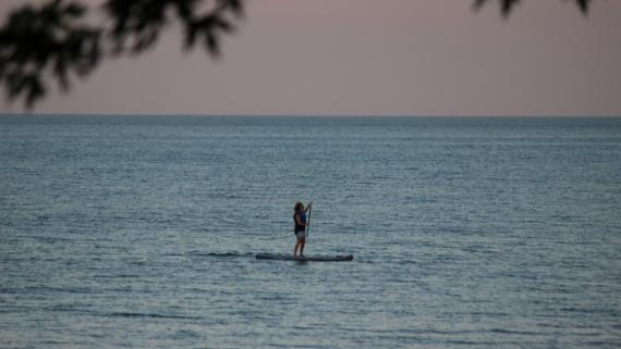 Woman paddleboarding at Tobey Prinz Beach
