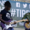 Two artists play guitar at a past TIP (Teens in the Parks) Fest.