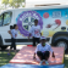 Children enjoy activities offered by the Rollin' Recreation program outdoors in a park.